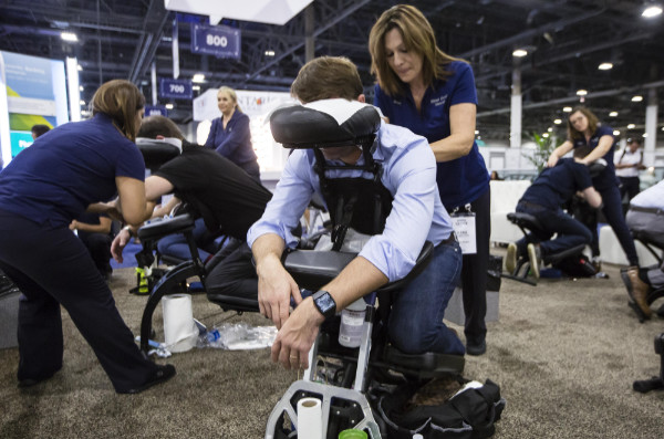 Attendees at Money 20/20 Conference receive chair massage in Las Vegas