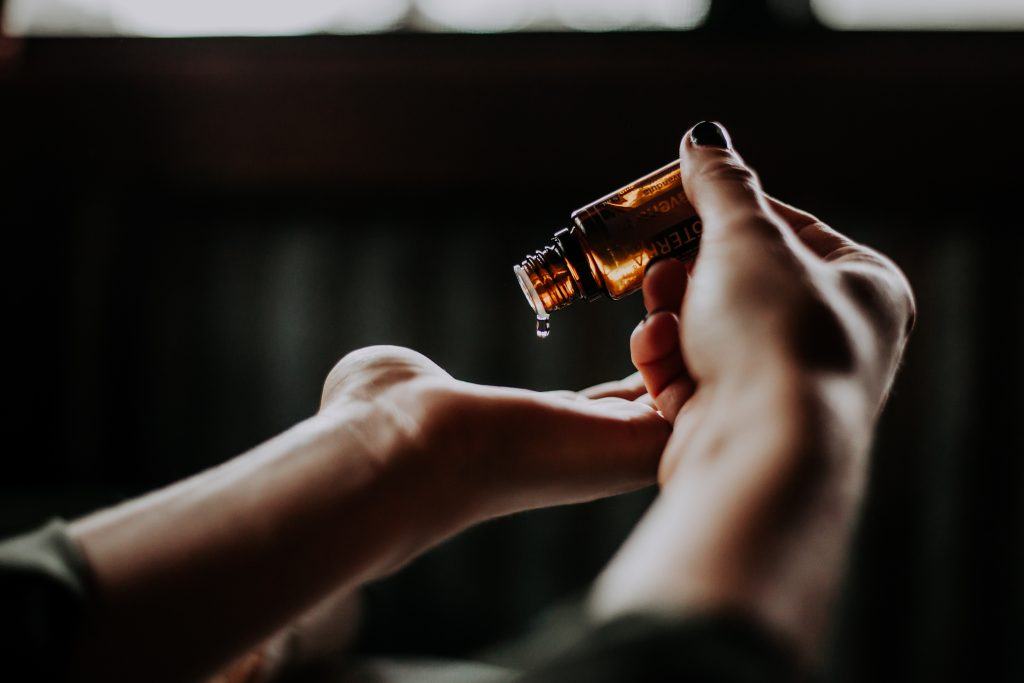 Hands with massage oil